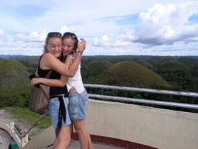 crazy daughters on Chocolate hills, Philippines